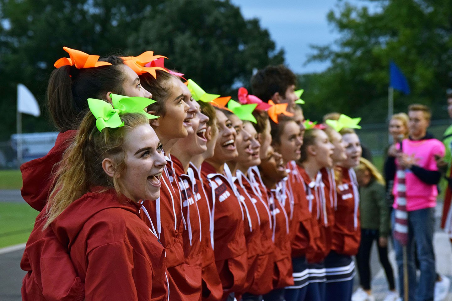 Junior Kailey Dunivan sings the Manhattan High School alma matter during the beginning of the MHS Varsity football homecoming game. At the start of every game the MHS cheer team leads the school in the alma matter, pumping up the crowd and showing school spirit. Homecoming week is filled with spirit days, a pep rally, the football game all leading up to the homecoming dance on Sep 29. Photo by Hailey Eilert