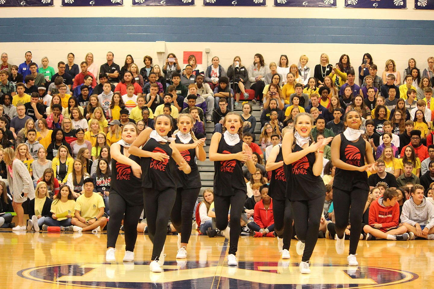 Dance It Up. The Manhattan High School dance team performs their up beat routine during Wednesday September 26. The crowd got riled up and was excited for the next event after the dance team.