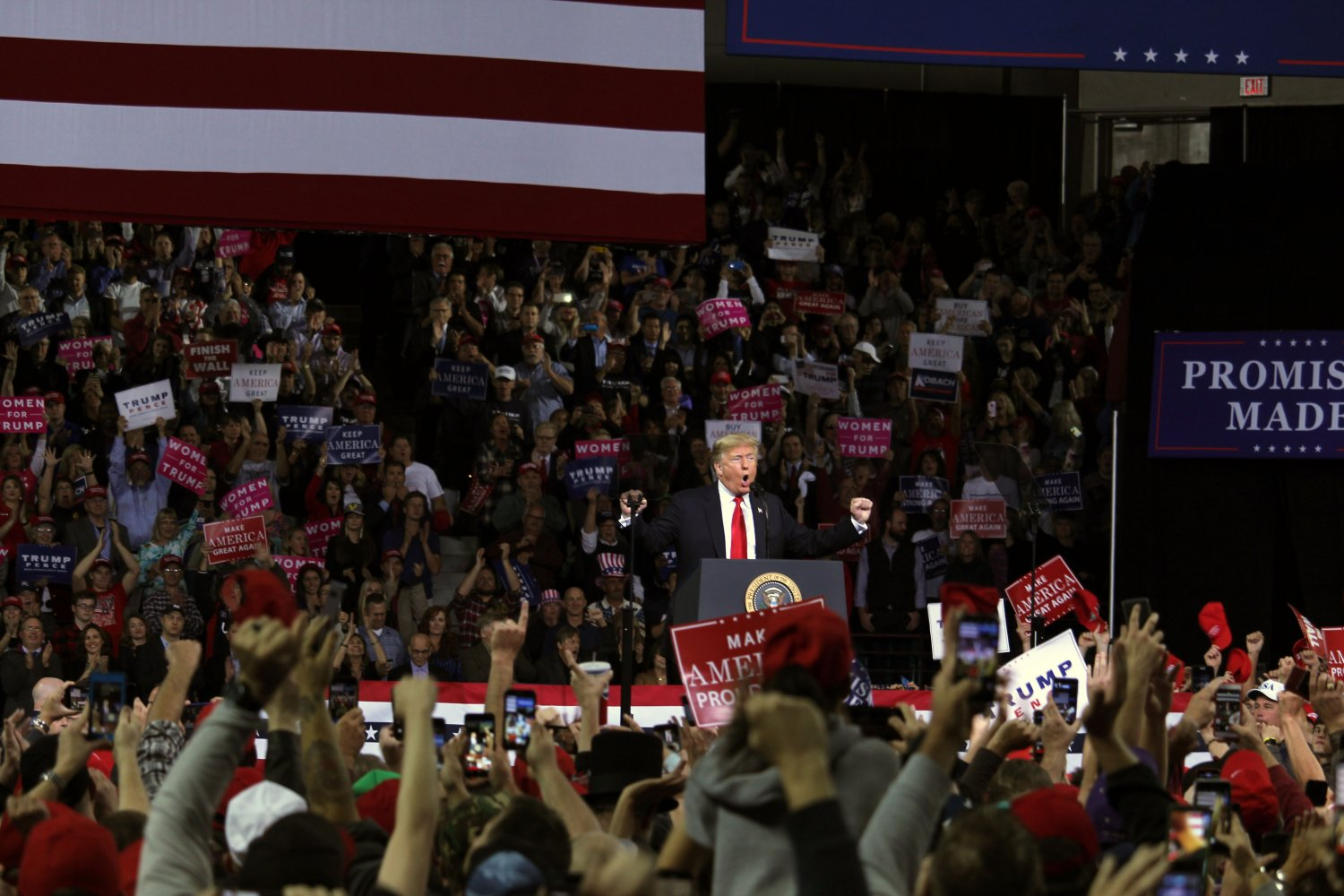 President Donald Trump pumps up the crowd at a campaign rally in Topeka, Kansas. The rally took place in the Expo Center and flustered in a crowd of around 11 thousand people in support of Trump's 2020 presidential run.