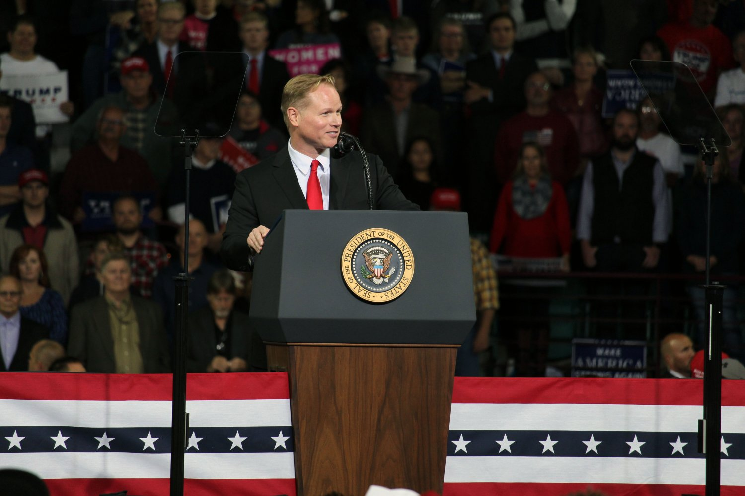 Candidate Steve Watkins addresses the audience at President Donald Trump's campaign rally in Topeka, Kansas on Oct. 6. Watkins appeared as an endorsed candidate for Senate and spoke about the importance of voting in primary elections as well as addressing his opponent's campaigns.