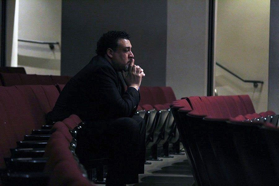 Director Nate McClendon sits in the third row of the Century II Theater as Chmaber Orchestra play String Quartet No. 8. His role for the performance was not to direct the group--as the audience previously thought--but to listen as they played, a tear running down his cheek as they finished.