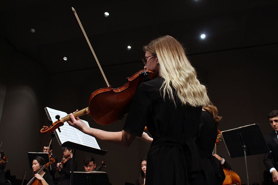 Senior Grace Hart rocks with the beat of String Quarttet No. 8, moving her body with each note to express the anger behind them. The piece, written by Dmitri Shostaovixh in the time of Stalin, expressed his sadness and rage toward those who practiced fascism. Photo by Sophia Comas