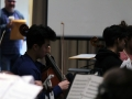 Senior Chris Chae sits in the first round of All-State rehaersal after auditioning for chair placements that morning. The rehearsal combined other students from Kansas who all played a piece specifically composed for their Saturday performance. Photo by Sophia Comas