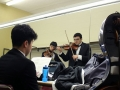 Juniors Brent Sol and Joshua Fan practice thier violin parts as senior Chris Chae studies his music in their dressing room. The group used their time in Witchita to rehearse for both their KMEA and All-State performaces that Friday and Saturday. Photo by Sophia Comas