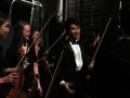 Senior Allen Zhang and sophomores Jenna Keeley and Aubrey Topham have a quick laugh backstage as they prepare themselves for the final moments before they perform. They and the rest of Chamber Orchestra came together to play String Quartet No. 8 for the Kansas Music Educators Assocition conference on Friday afternoon. Photo by Sophia Comas