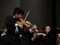 Senior Allen Zhang plays intensely to Shostakovich's String Quartet No. 8, which is meant to express both the sadness and anger he felt during the World War II era. His self-written requiem required that the Chamber Orchestra play aggresively, resulting in broken bow strings. Photo by Sophia Comas