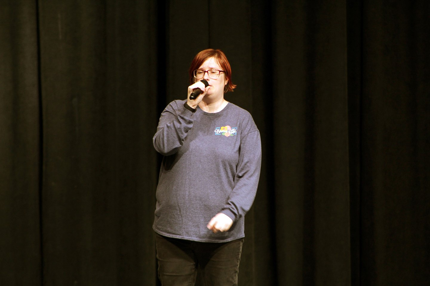 """Jamie Chambers, community member, practices her cover of the 2008 Taylor Swift song """"You Belong with Me""""."""