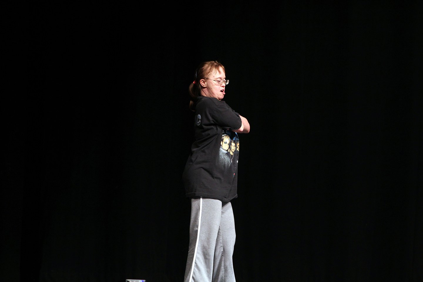 """Community member Amy Kells starts off in a pose for her dance routine to """"Everybody (Backstreet's Back)"""" by the Backstreet Boys."""