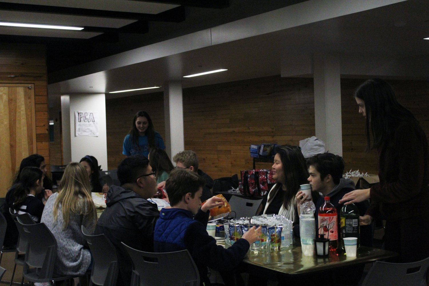 As the fun begins, members from other clubs continue to arrive, grabbing themselves snacks and drinks before they find their spots at the table. Photo by Kyla Barnett