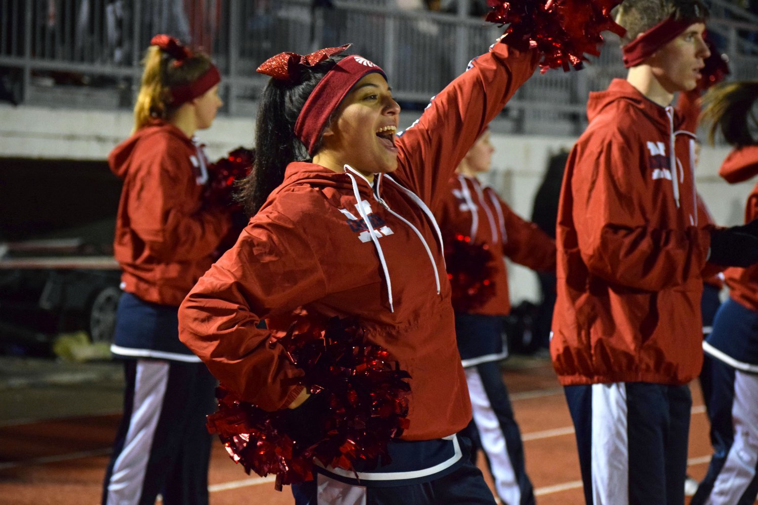 Senior Mya Brown cheers on the MHS Indians on the sidelines of the Junction City game. The cheerleaders took a break from their normal uniforms to stay warm for the cold game on Oct. 11, wearing instead pullovers, sweats, and gloves. The final score of the game was 31-28 another win for the MHS varsity team. Photo by Hailey Eilert.