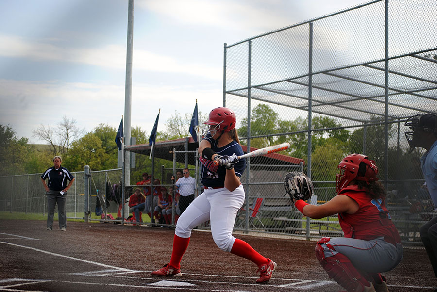 Junior+Anna+Batt+swings+her+bat+to+make+contact+with+the+ball.+Batt+also+pitched+Manhattan%27s+4-1+loss.
