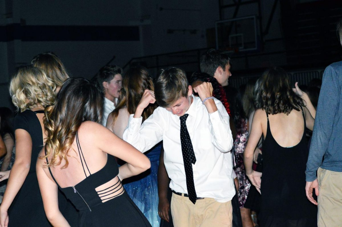 Seniors Cooper Schroeder and Addy Stone dance at homecoming. The dancing with all my friends and listening to the music was my favorite part, also not having to put up with the stress of a regular day, Schroeder said.