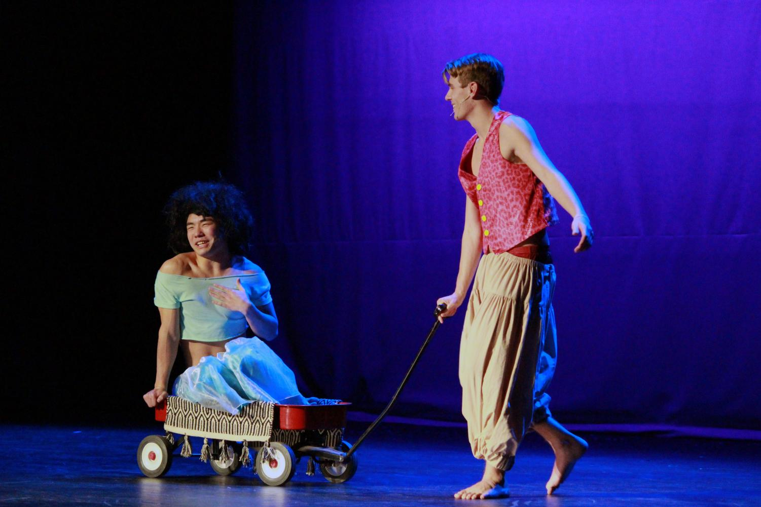 Junior Suman Wang rides on the 'magic carpet' helping senior Will Erickson with his performance of the beloved Disney movie