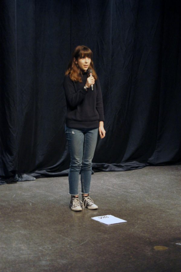 Junior+Katharina+Ohler+recites+her+poem+%22December+5th%22+at+the+third+annual+Poetry+Slam.+Ohler+summited+another+poem+%22January+27th%22+and+went+on+to+win.