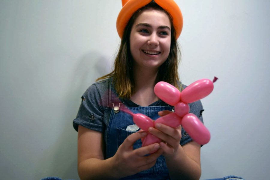 Freshman+Hailey+Eilert+practices+tying+balloons+into+dogs+and+various+animals+in+her+free+time.+Although+balloon+tying+may+not+be+a+fine+art+class+offered+at+Manhattan+High+School%2C+classes+that+are+fine+art+promote+the+individuality+of+students+and+encourage+them+to+try+new+things.+%E2%80%9CBalloon+animals+are+a+cool+way+to+bring+joy+to+others%2C%E2%80%9D+Eilert+said.+It%E2%80%99s+really+fun+to+see+someone%E2%80%99s+face+light+up+when+I+give+them+an+animal.%E2%80%9D+Photo+by+Makenna+Eilert