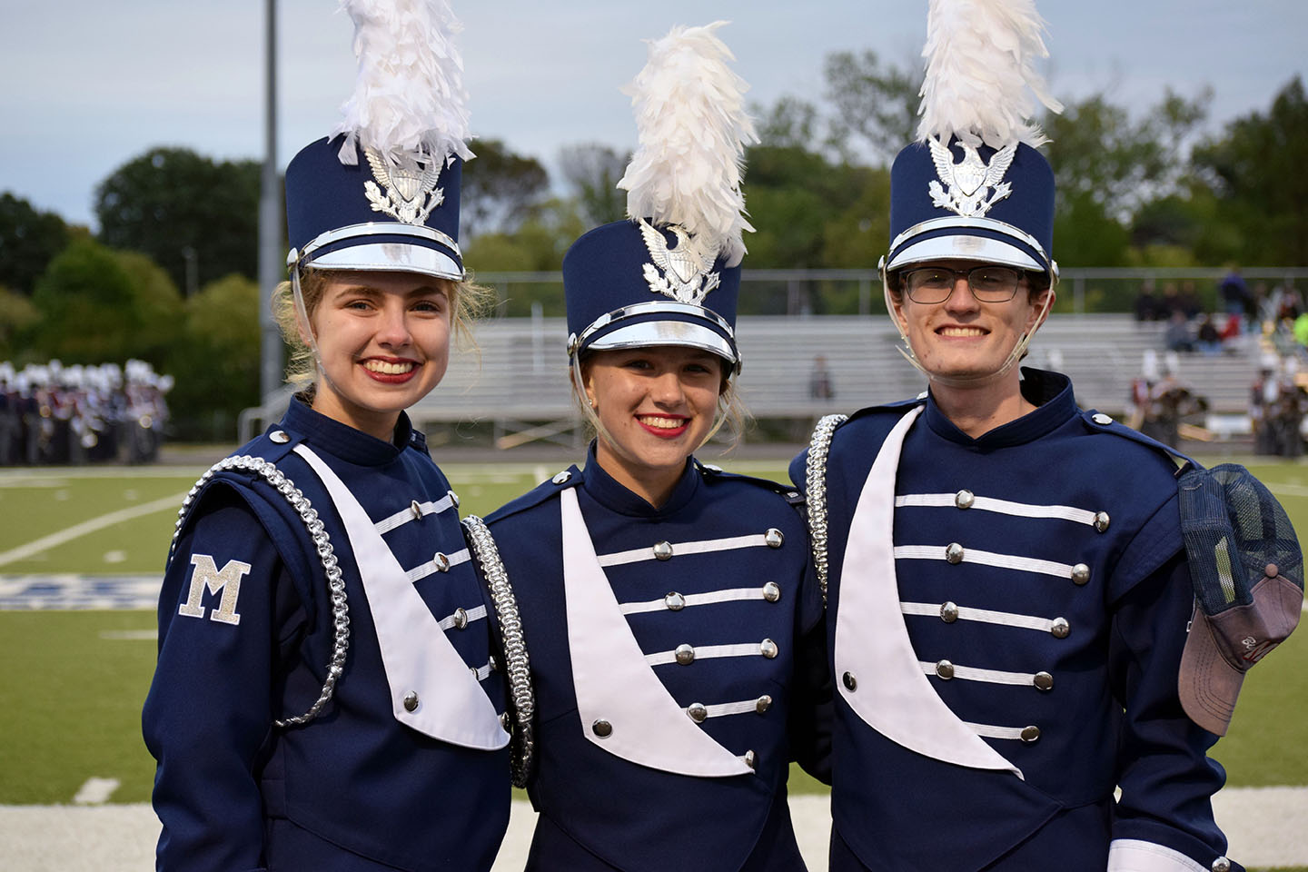 Big Blue Marching band Drum Majors (left to right) Tess Garvin, senior; Maggie Fontanini, junior; and Chris Carter, senior, in uniform at Bishop Stadium.