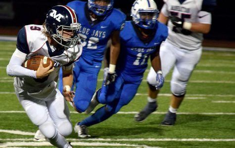 Varsity football dominates at Topeka West