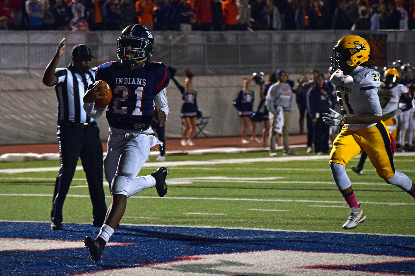 Senior Kevontae McDonald runs the balls into the endzone during the Oct. 26 Manhattan High School Varsity football game. The Indains defeated Wichita Southeast High School 73-20, adding another win to their current season.