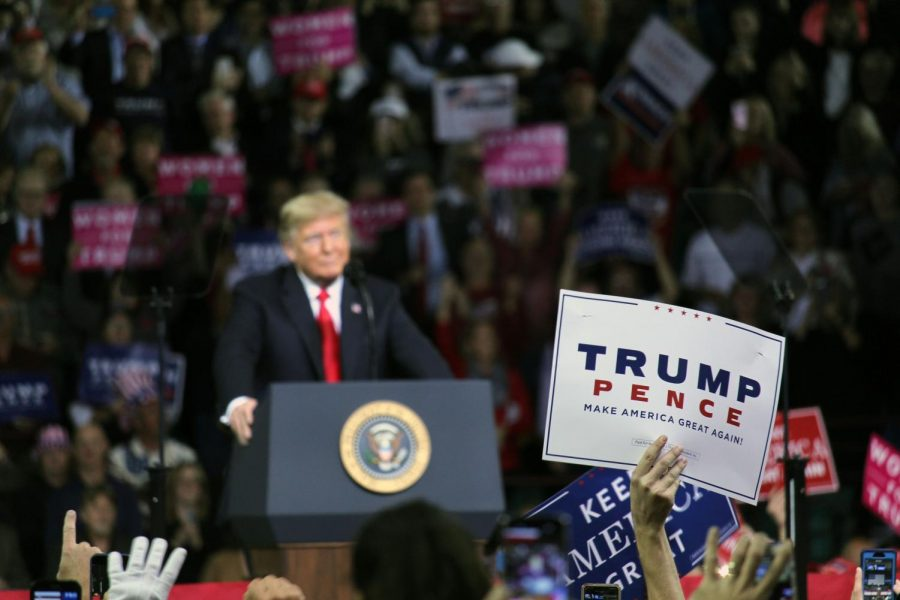 A member of the crowd hold up a sign as President Donald Trump speaks. Trump spoke in Topeka, Kansas on Oct. 6 to show support for Secretary of State of Kansas Kris Kobach, who is running for governer, and Steve Watkins, who is running for Senate, while also promoting his 2020 campaign.