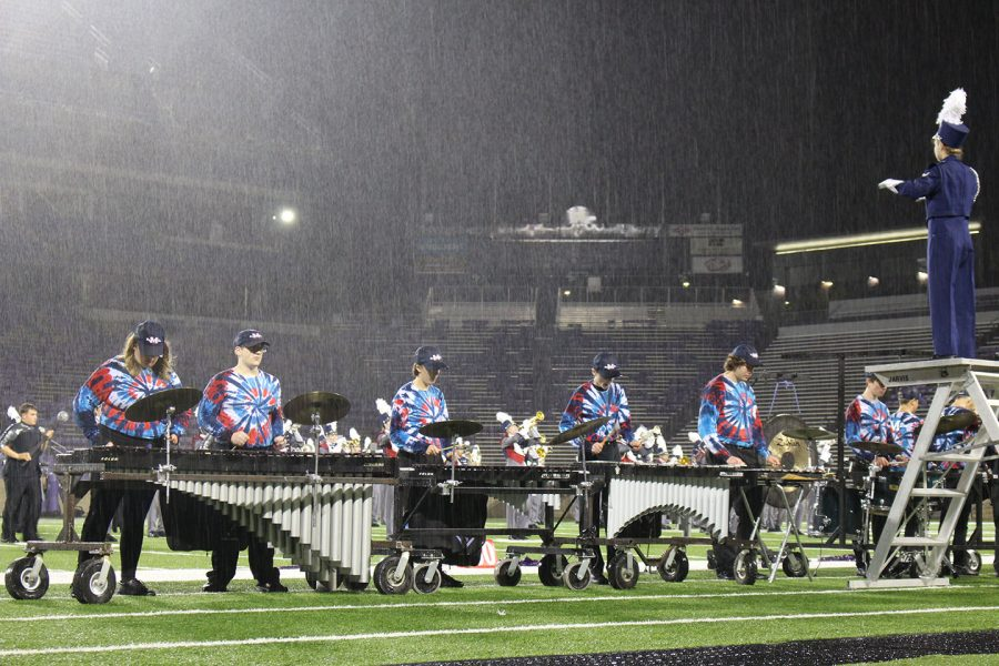 Members of the pit perform in the rain during the band festival. The Manhattan High School Big Blue Marching Band participated in the annual band festival, there, they were judged and awarded a score for their performance.
