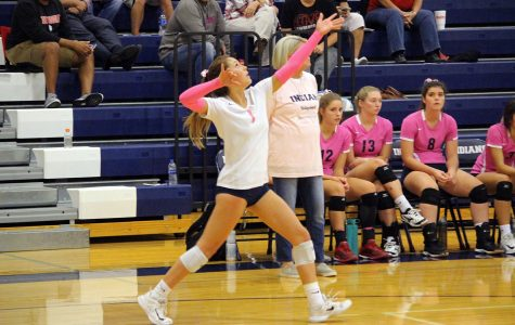 Senior Haleigh Harper serves the ball during the Manhatan High School senior night. Senior night was Oct. 9, where the Lady Indians played against their league rivals Emporia.