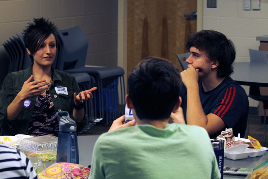 Sunset Zoo Science Communications Fellow Lisa Vangsness talks about her profession and research as junior Alex Andresen listens. Students had the opportunity at lunch to come together and listen to Vangsness through the Teen Science Cafe series.