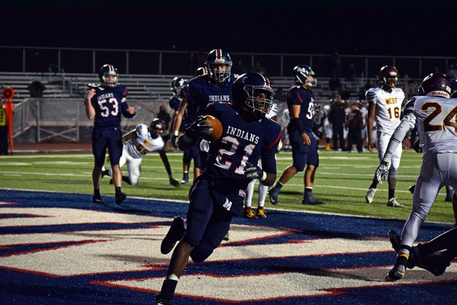 Senior+Kevontae+McDonald+runs+the+ball+in+for+the+extra+point+at+the+Nov.+2+Manhattan+High+School+Varsity+football+game.+The+Indians+played+against+Wichita+Southwest+beating+them+36-25.+
