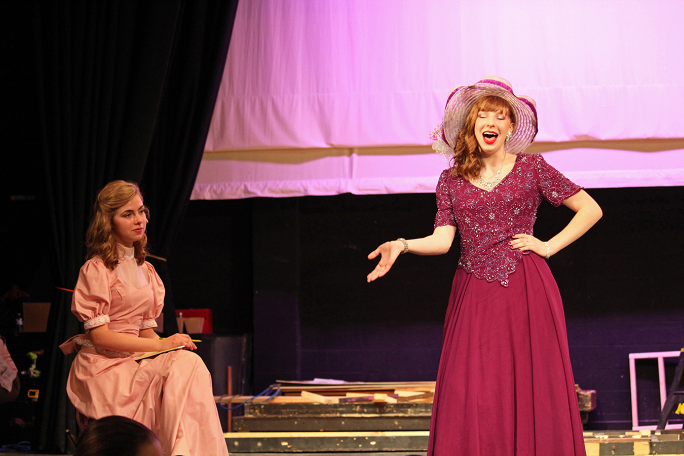 Seniors Tess Garvin and Jana Kellogg reherse for the fall musical. The fall musical is