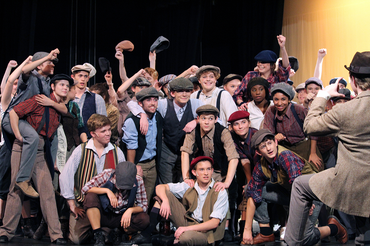 The cast of Newsies acts during a scene from the Manhattan High Schools fall musical. TThe musical this year is