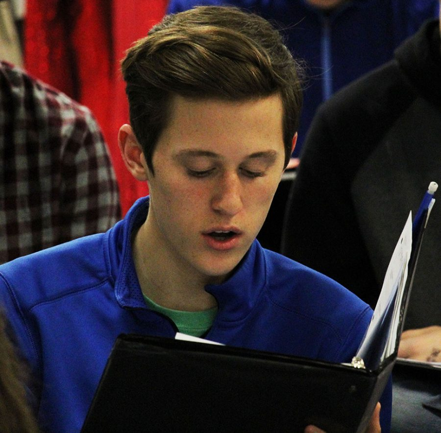 Junior Tysen Plummer pratices with the sixth hour choir. Plummer also participates in the musical in the chores.