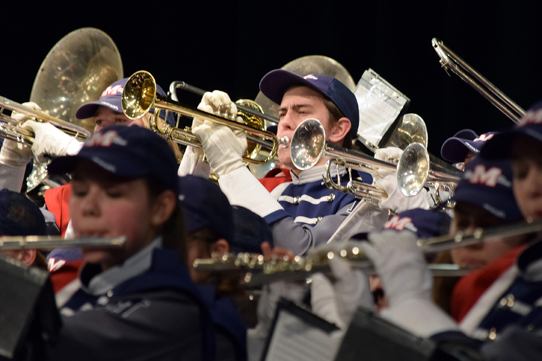 "Junior Ethan Myer performs songs from the Manhattan High Big Blue Marching Band's set ""Bluehemian Rhapsody"" during the band concert on Nov. 29."