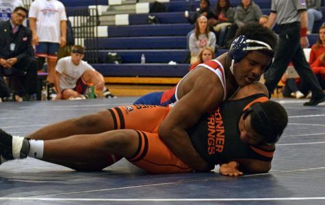 Senior Robert Houston takes down his opponet during the senior night wrestling tournament on Thursday.