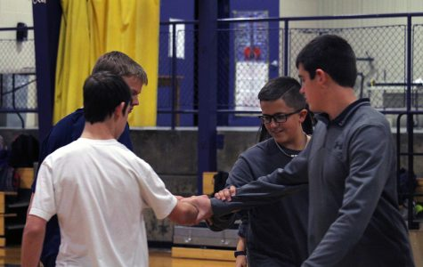 Freshmen Connor Bruce, Paul Batt, Evan Bratt and Cade Mcilbaine square dance during freshman P.E. The freshman have been learning and practicing square dancing for the past two weeks. Photo by Javi Mercado
