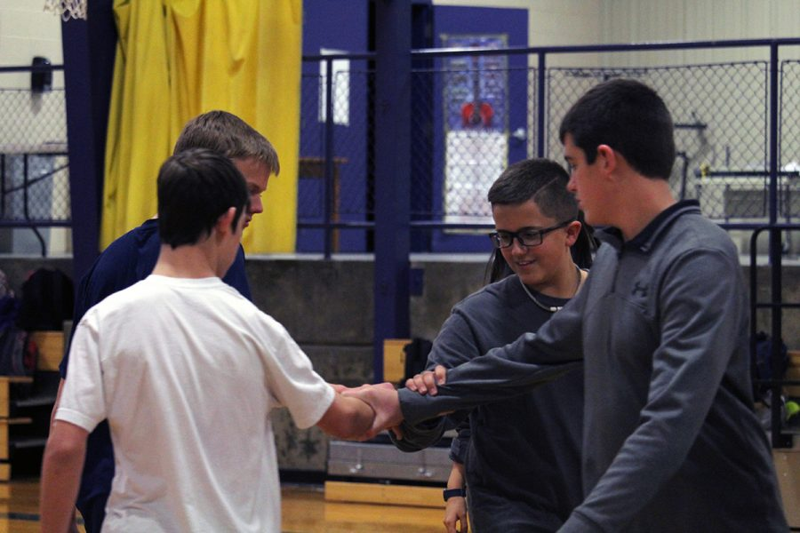 Freshmen+Connor+Bruce%2C+Paul+Batt%2C+Evan+Bratt+and+Cade+Mcilbaine+square+dance+during+freshman+P.E.+The+freshman+have+been+learning+and+practicing+square+dancing+for+the+past+two+weeks.+Photo+by+Javi+Mercado