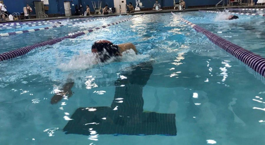 Boys swim team places first despite missing team members