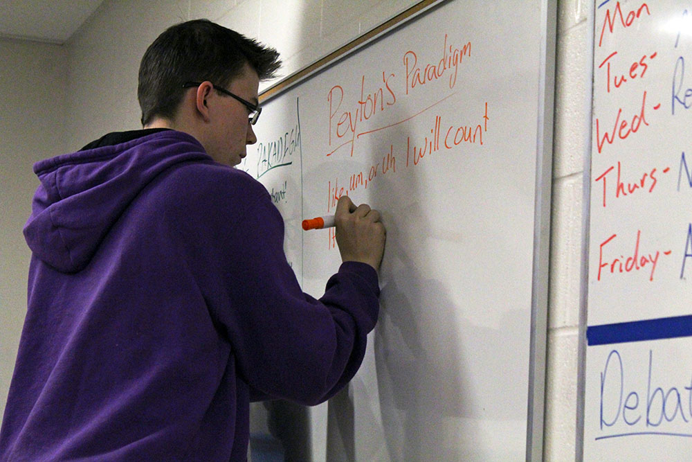 Junior Peyton Woods prepares his paradigm for a mock-competition after school.