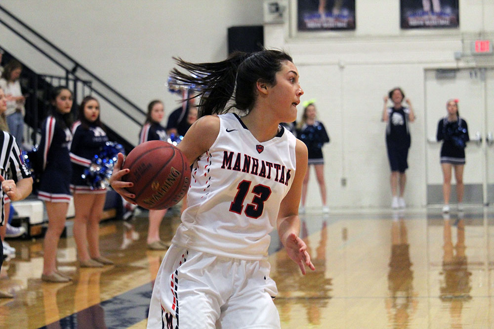 Senior Haleigh Harper runs with the ball during the Lady Indian varsity game against Emporia. The Indians won the game 54-23.