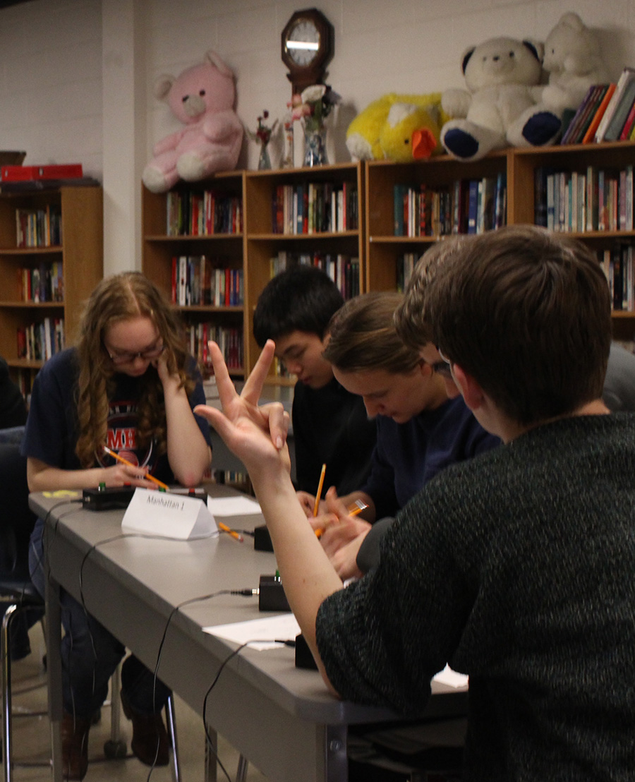 The MHS Scholars Bowl team works to complete a math question during the Scholars Bowl competition on Jan. 28.