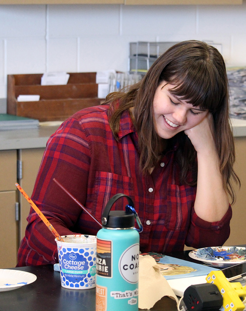 Senior Ashley Savage works on her painting. Savage won the high school divison award for the Martin Luther King Jr contest, this year's theme was