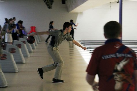 Junior Grant Terill readies to bowl the ball during the Manhattan High School bowling meet on Feb. 5.