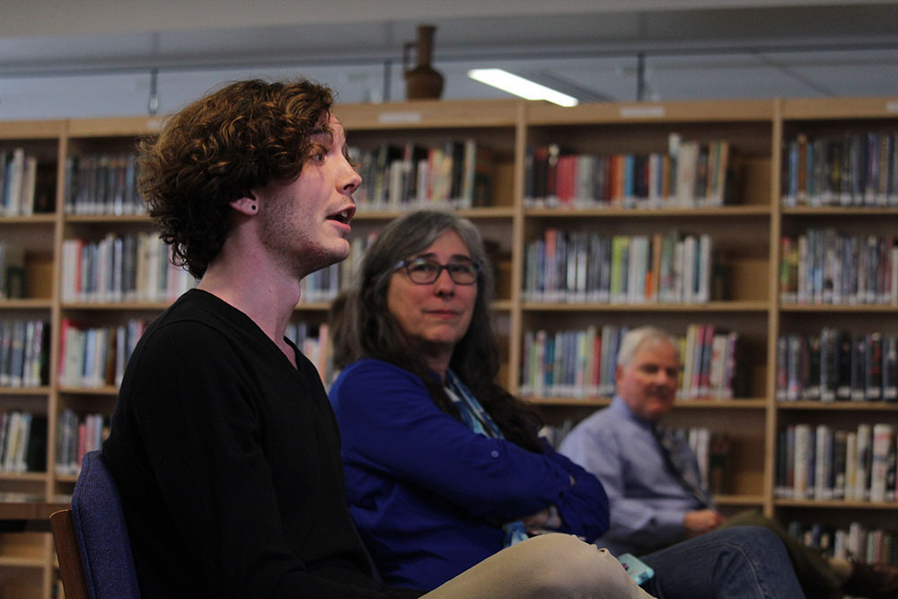 Senior Jacob Wineland addresses new principal candidate Martin Straub with a question while teacher Leslie Campbell listens. Wineland attended the meet-and-greet on Friday after school with questions pertaining to student equality and minority groups.