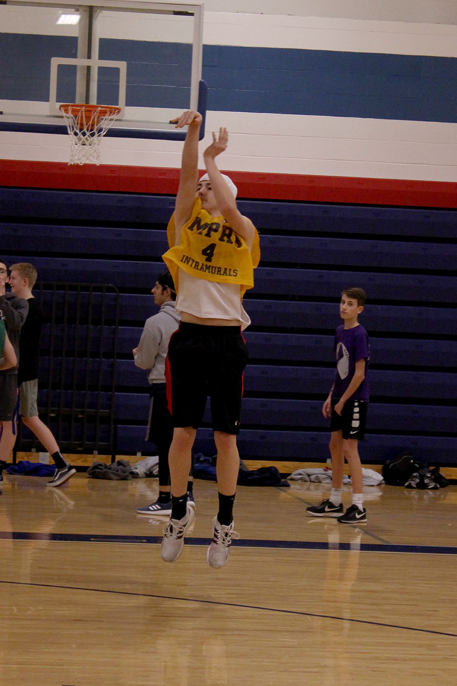Senior Mason Jackson shoots the ball during his team's warm-up time at the intramural basketballl games on Feb. 5. Jackson's team the L.A. Leakers first game of the night was against the Star-Spangled Ballers.