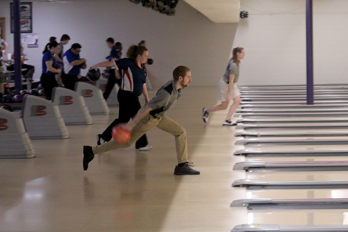 Senior Michael Moran bowls at the bowling meet on Feb. 5 at Little Apple Lanes.
