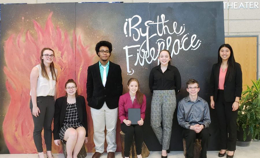 Manhattan High Forensics team poses in front of the theater at the Olathe North West tournament. The team went home with two bids for the National Tournament in April and semifinalist rankings.