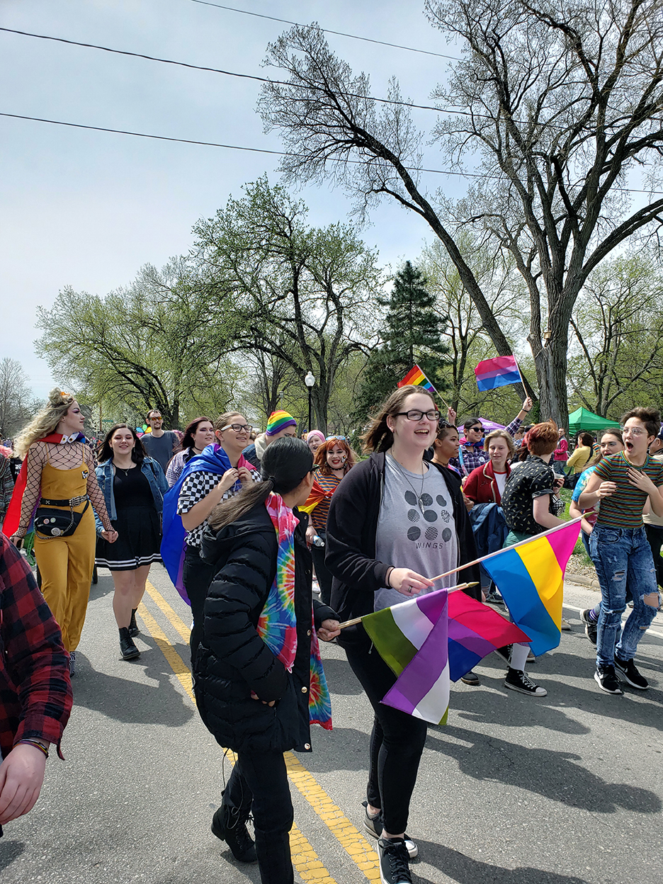 MHS students and other attendees at MHK Pride walk together down Poyntz Ave on April 13.
