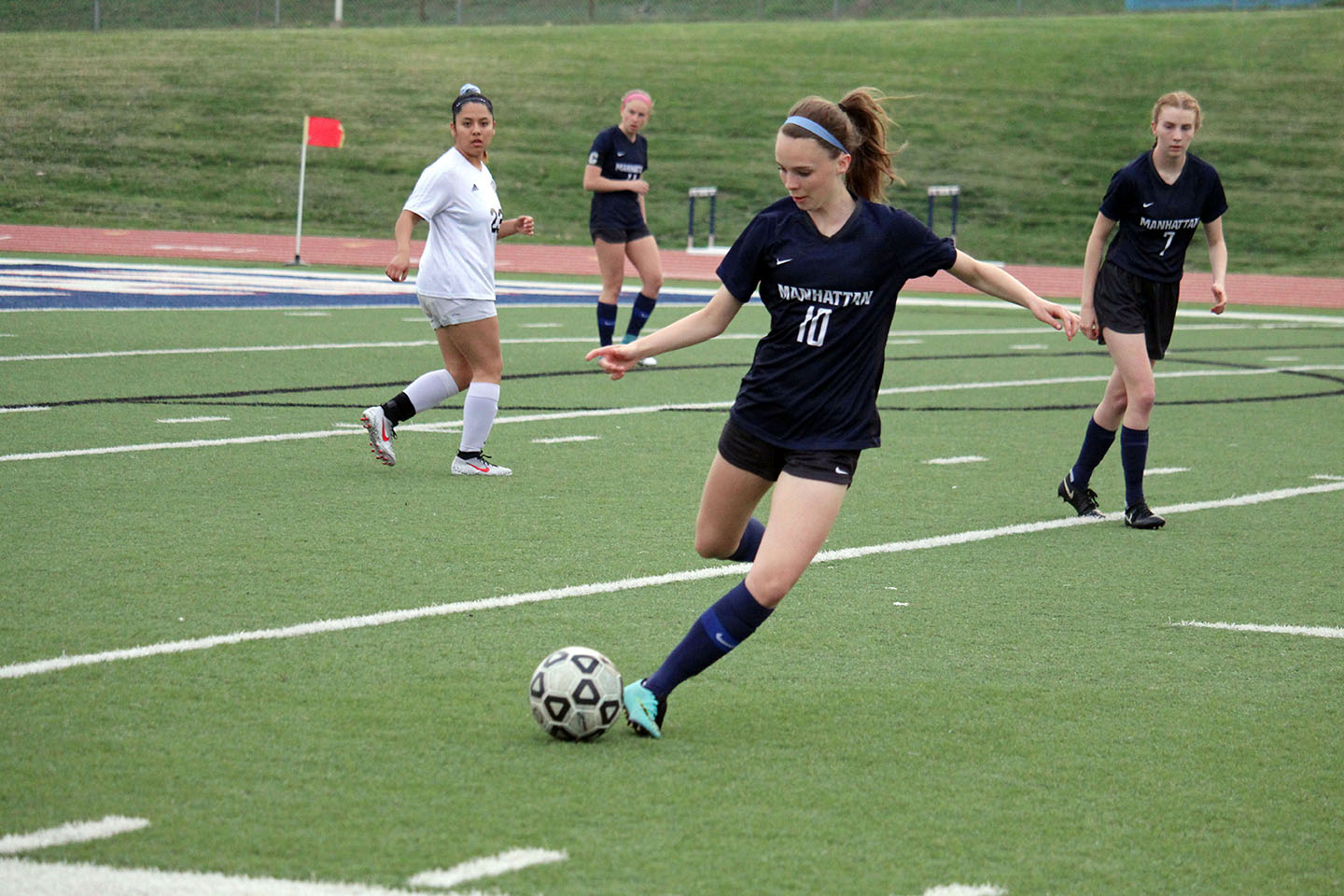 Junior Ainslie Markle keeps possession of the ball during the Lady Indians j.v. soccer team's game against Emporia on April 9.