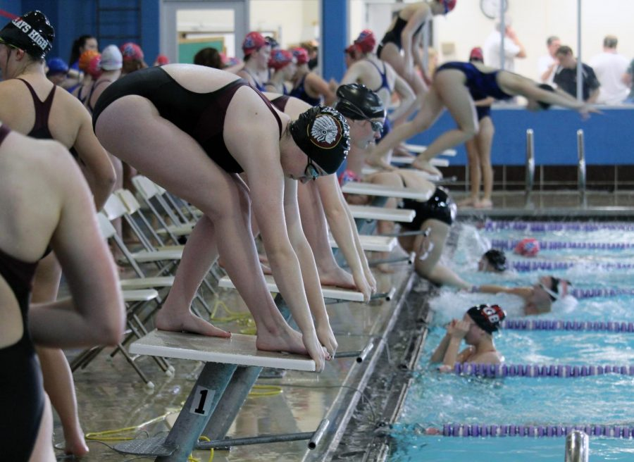 Girls+Swim+and+Dive+get+ready+to+pounce+into+the+water+to+make+a+splash.+They+competed+against+Hays%2C+Junction+City%2C+and+Great+Bend+on+April+15.