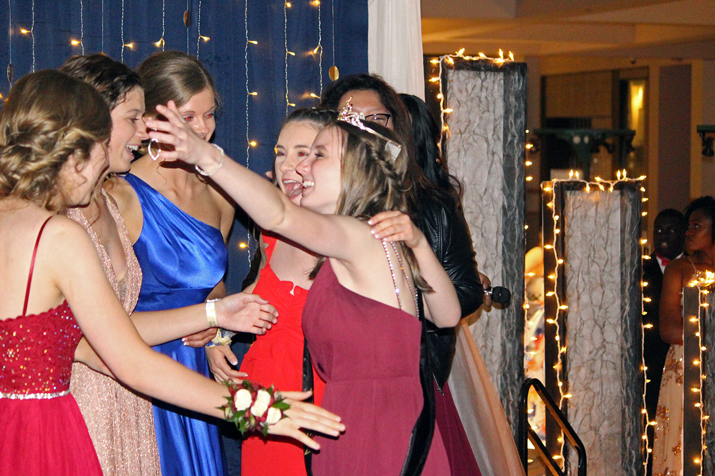 Senior Cami Wells hugs her fellow prom queen nominees after being announced as the 2019 prom queen. Along with Wells, senior Jered Zhang was voted in as prom king.