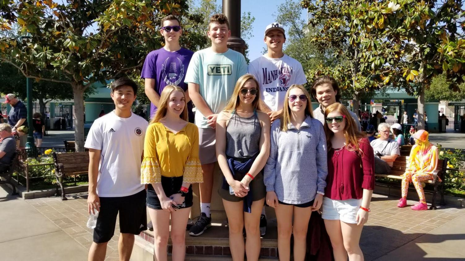 From front to back, sophomore Rayma Last, sophomore Brandy Sullivan, junior Hannah Higgins, sophomore Rhys Phipps, junior Will Bannister and junior Alison Payne, junior Casey Gritton, junior Collin Devan and junior Tyler Higgins pose for a photo during their BPA trip in California.