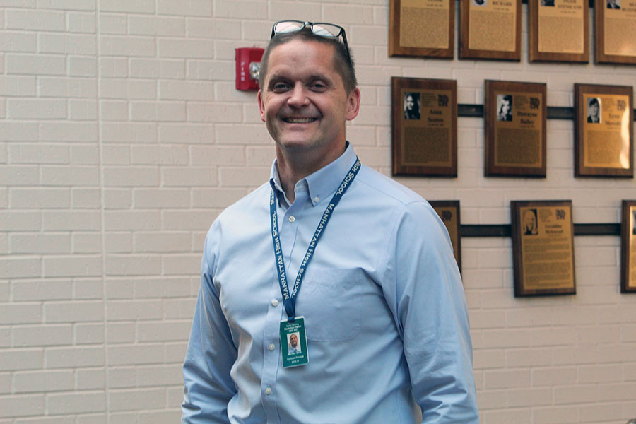Principal Michael Dorst stands in his favorite spot within Manhattan High's West Campus located along